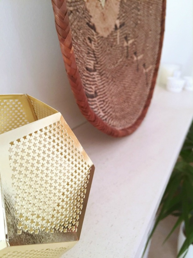 Gold tealight on mantel