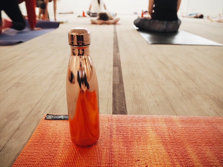 rose gold water bottle on yoga mat