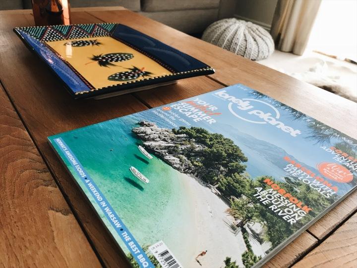 Loney planet magazine on table